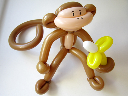 monkey-balloon-sculpture-robert-moy-designer-artist-banana-kids-children-enterainment-fun-williamsburg-brooklyn-photo